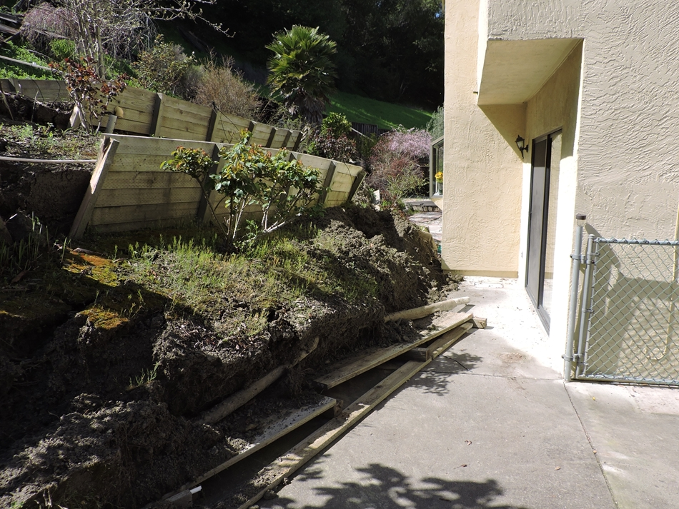 Terraced backyard sliding toward the house