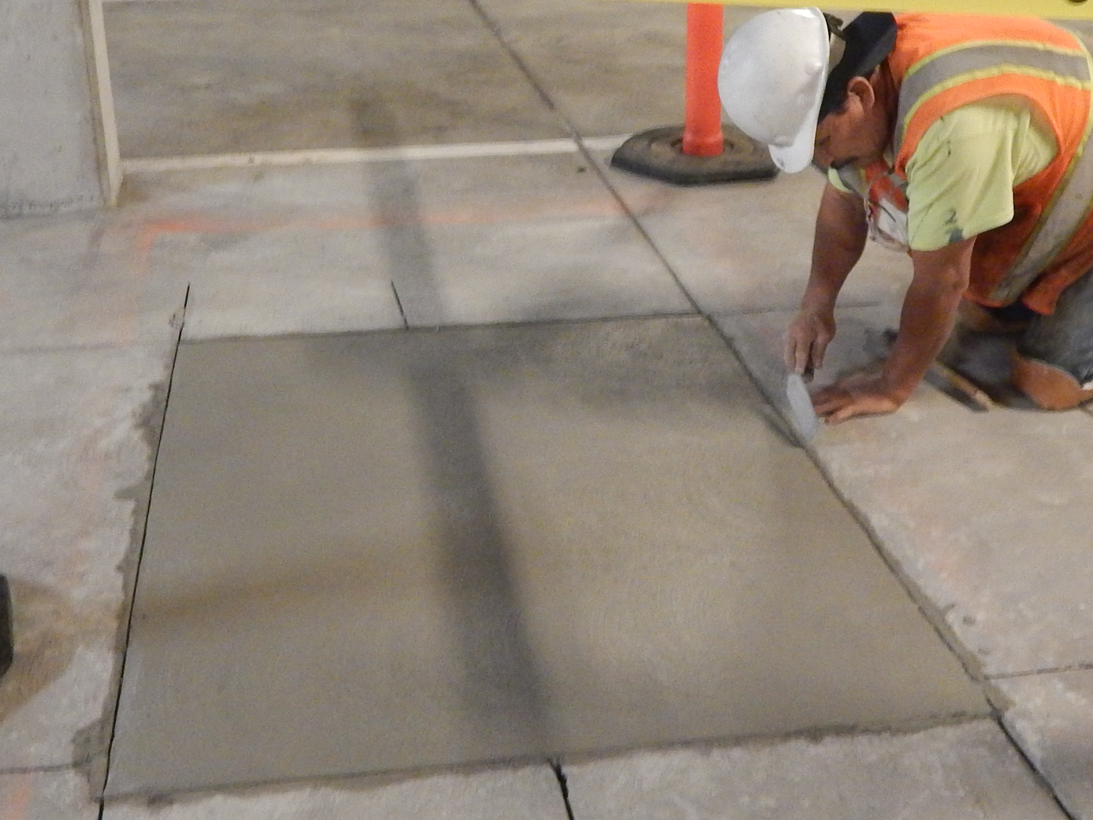 Hand finishing the concrete